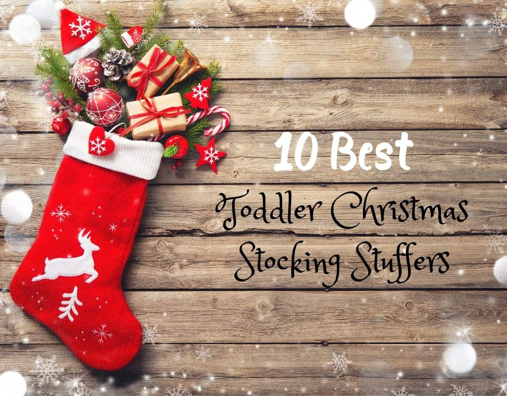 Red Stocking with presents coming out. Stocking is laid on a hardwood floor background. Text says 10 Best Toddler Christmas Stocking Stuffers
